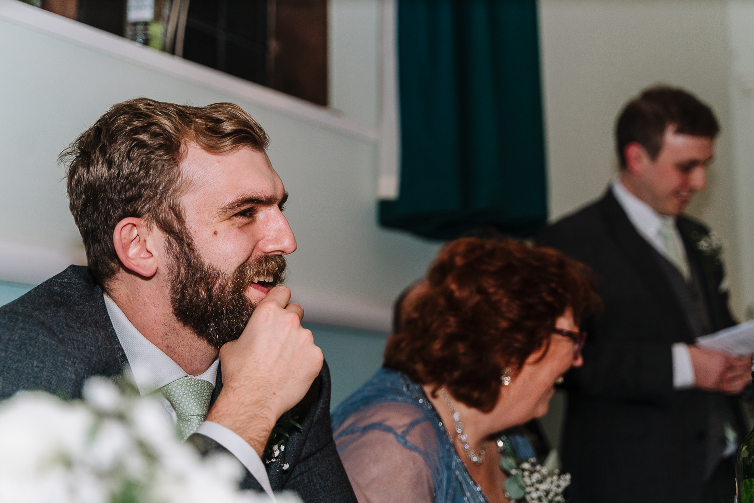 Best man speech and groom laughing