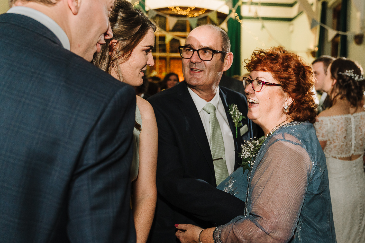 Parents of the couple dancing