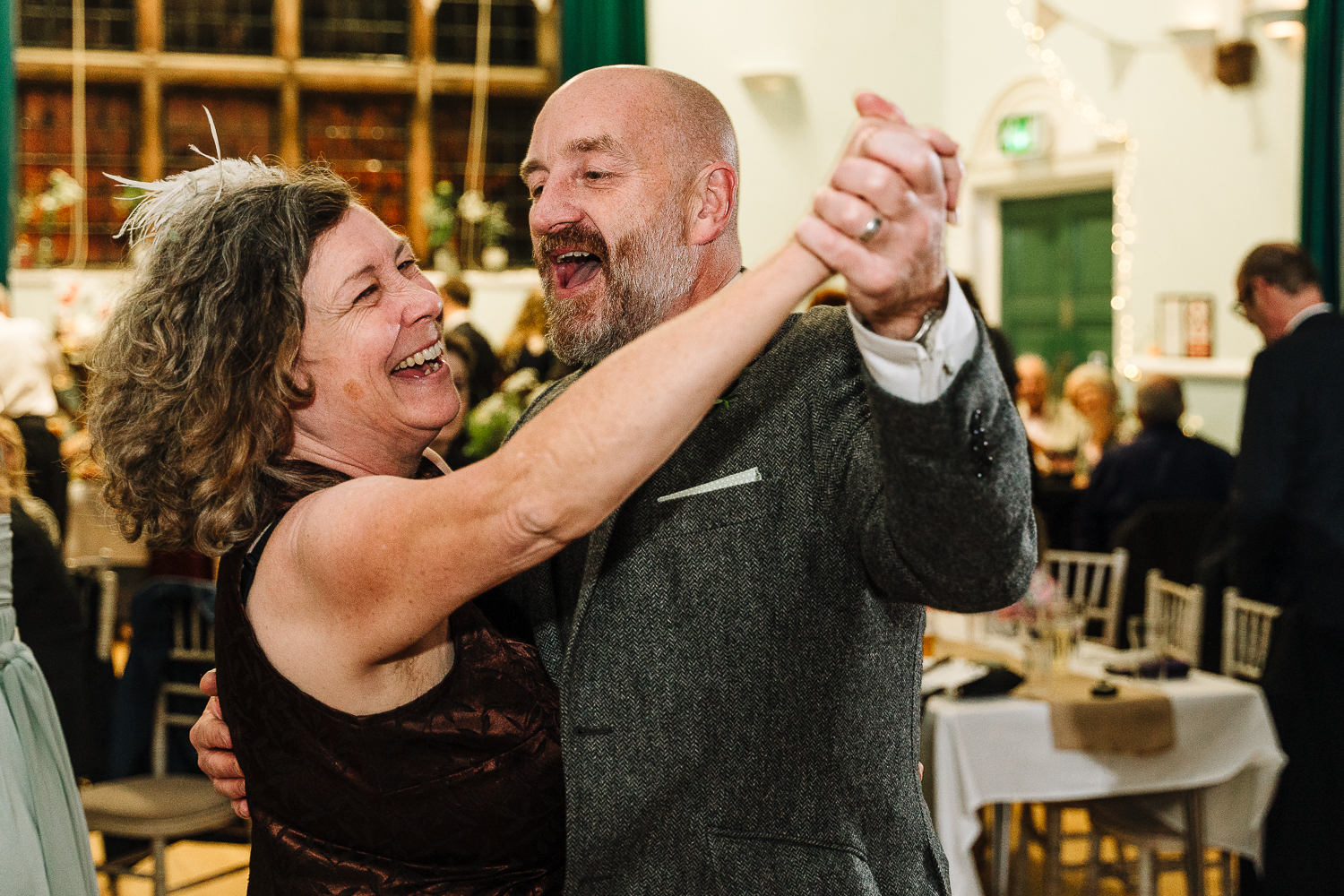Father of bride dancing with guest