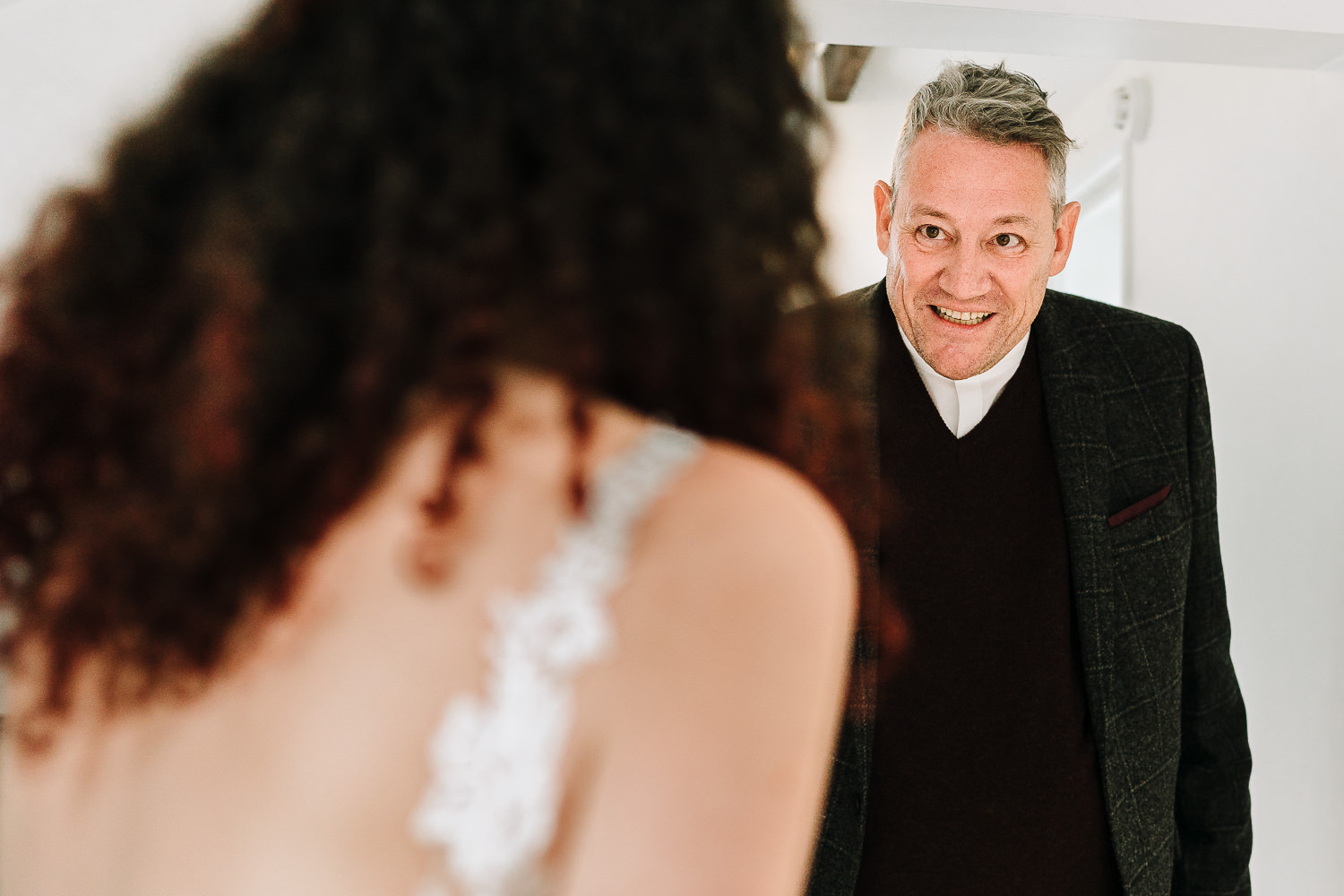 father of the bride walking into the room to see the bride