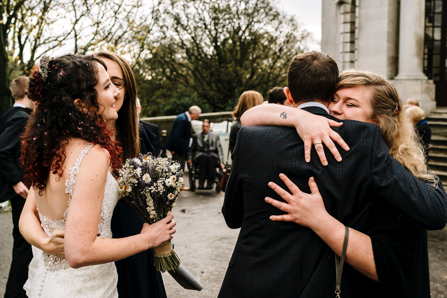 hugs from couples after the ceremony
