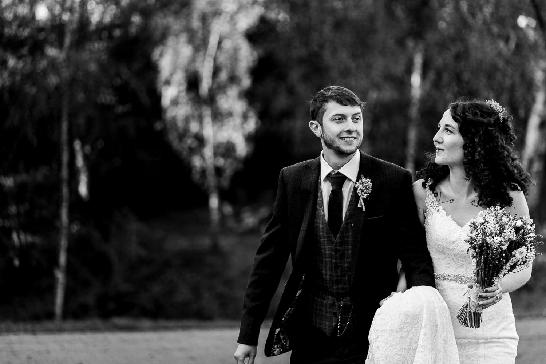 Bride and groom walking in Williamson Park, Lancaster.