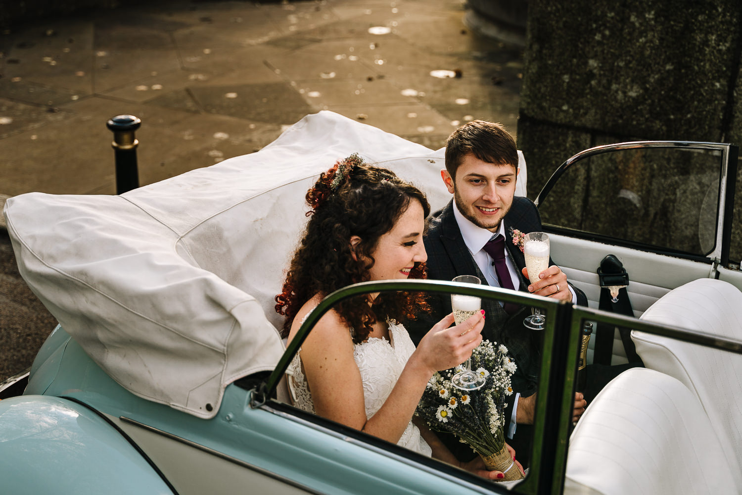 bride and groom in the car outside Ashton Memorial in the car