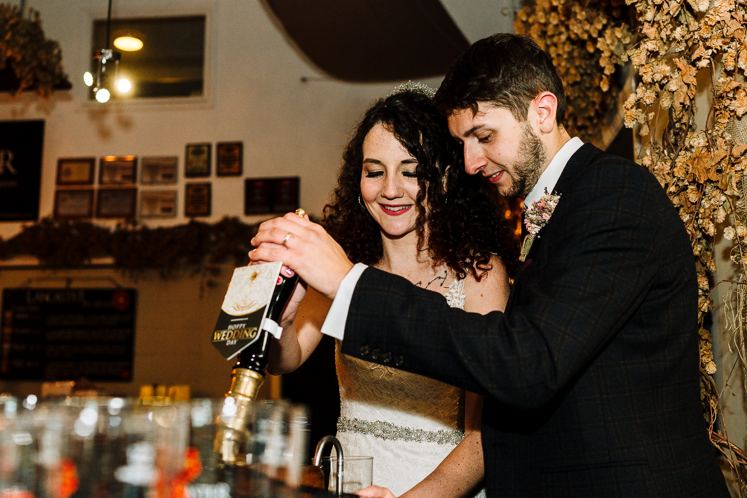 Bride and groom pulling a pint at Lancaster Brewery