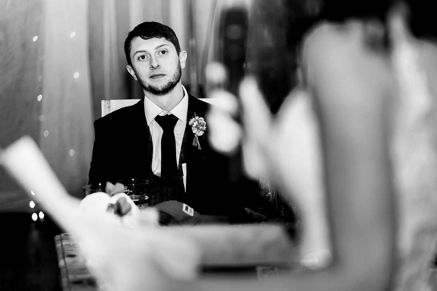 Groom looking on to Brides speech