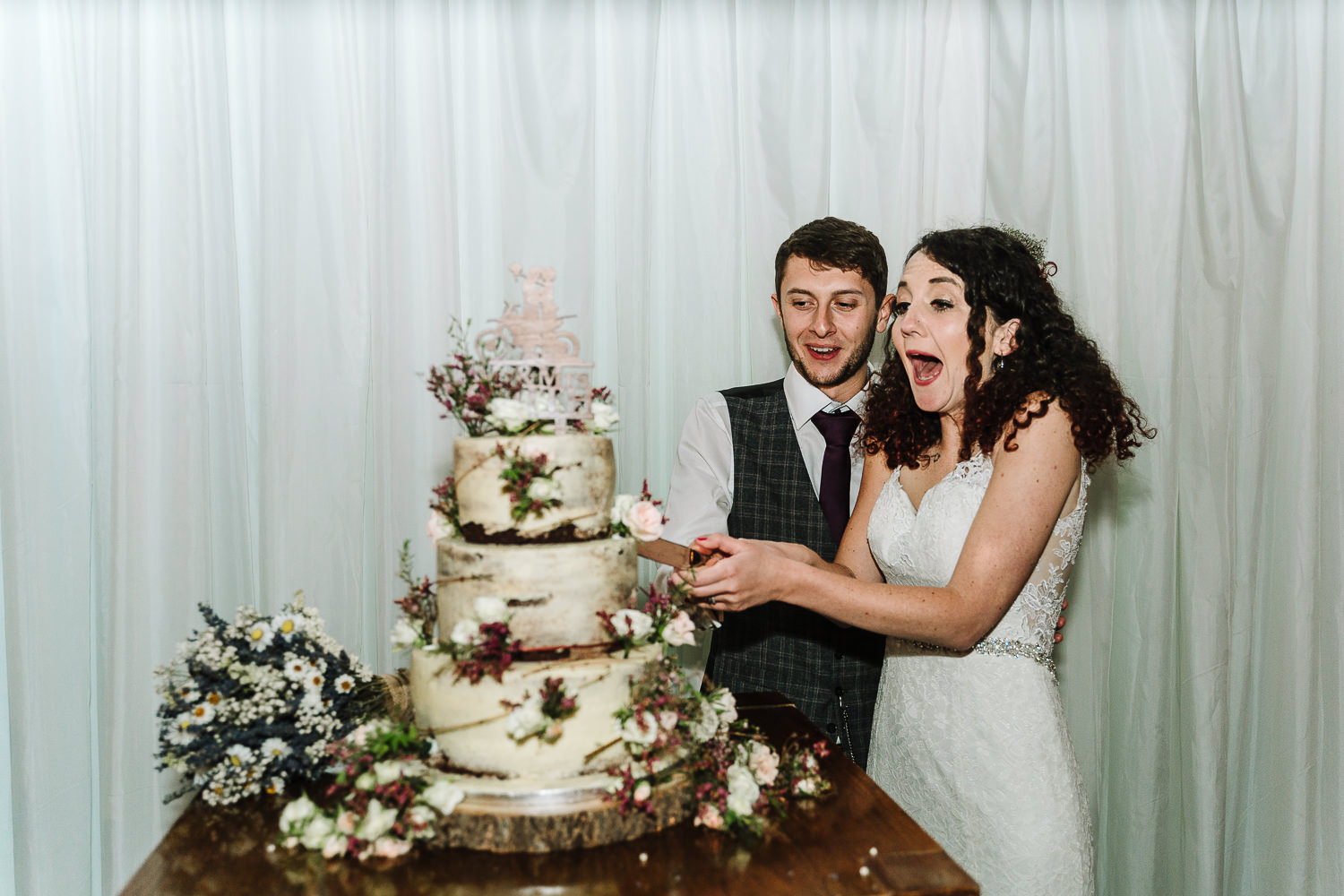 Bride and groom cutting the cake at Lancaster Brewery