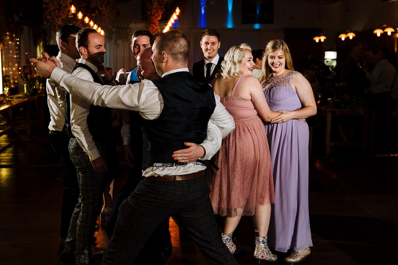 Lots of guests dancing