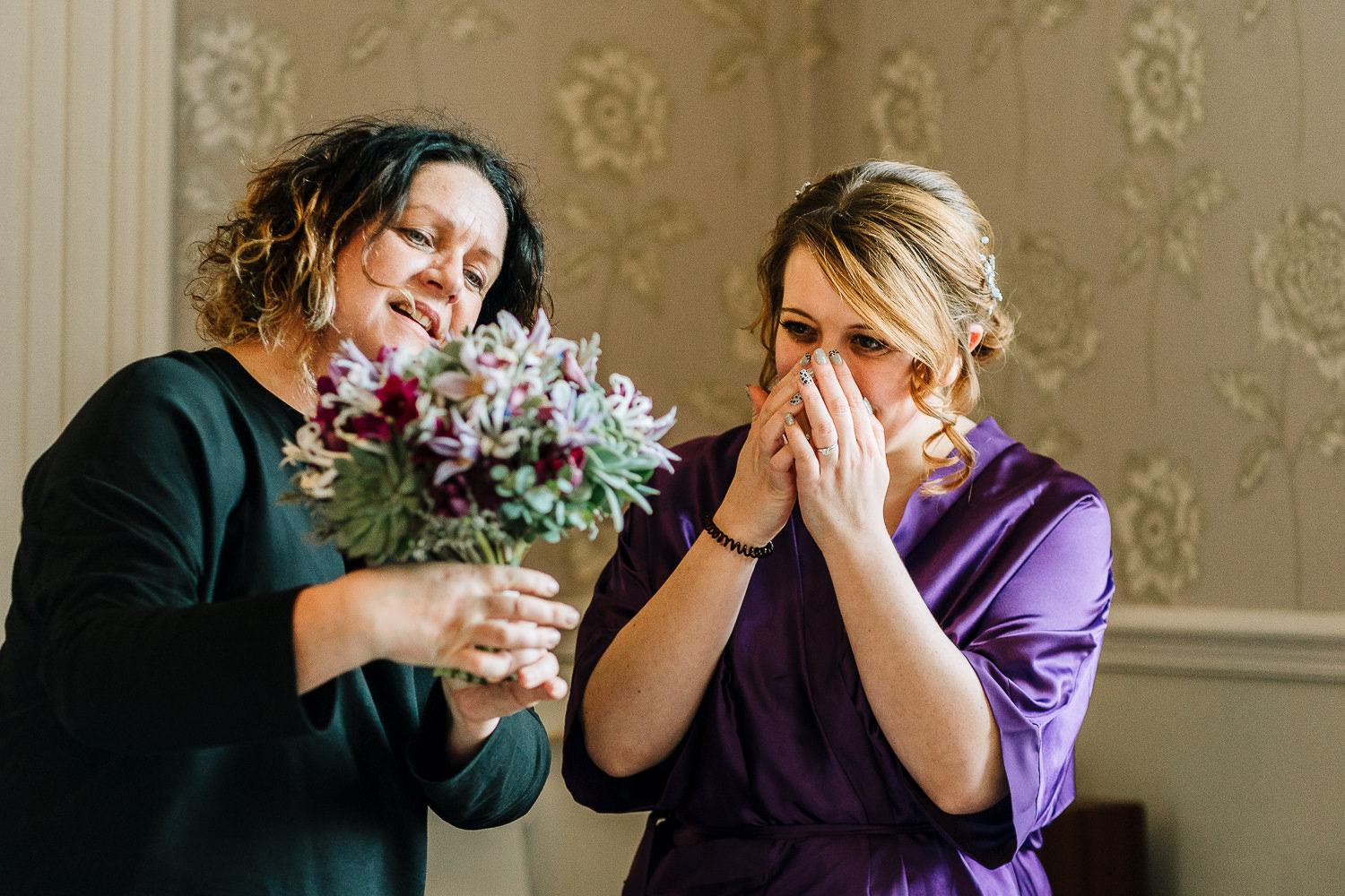 Bride crying seeing her flowers