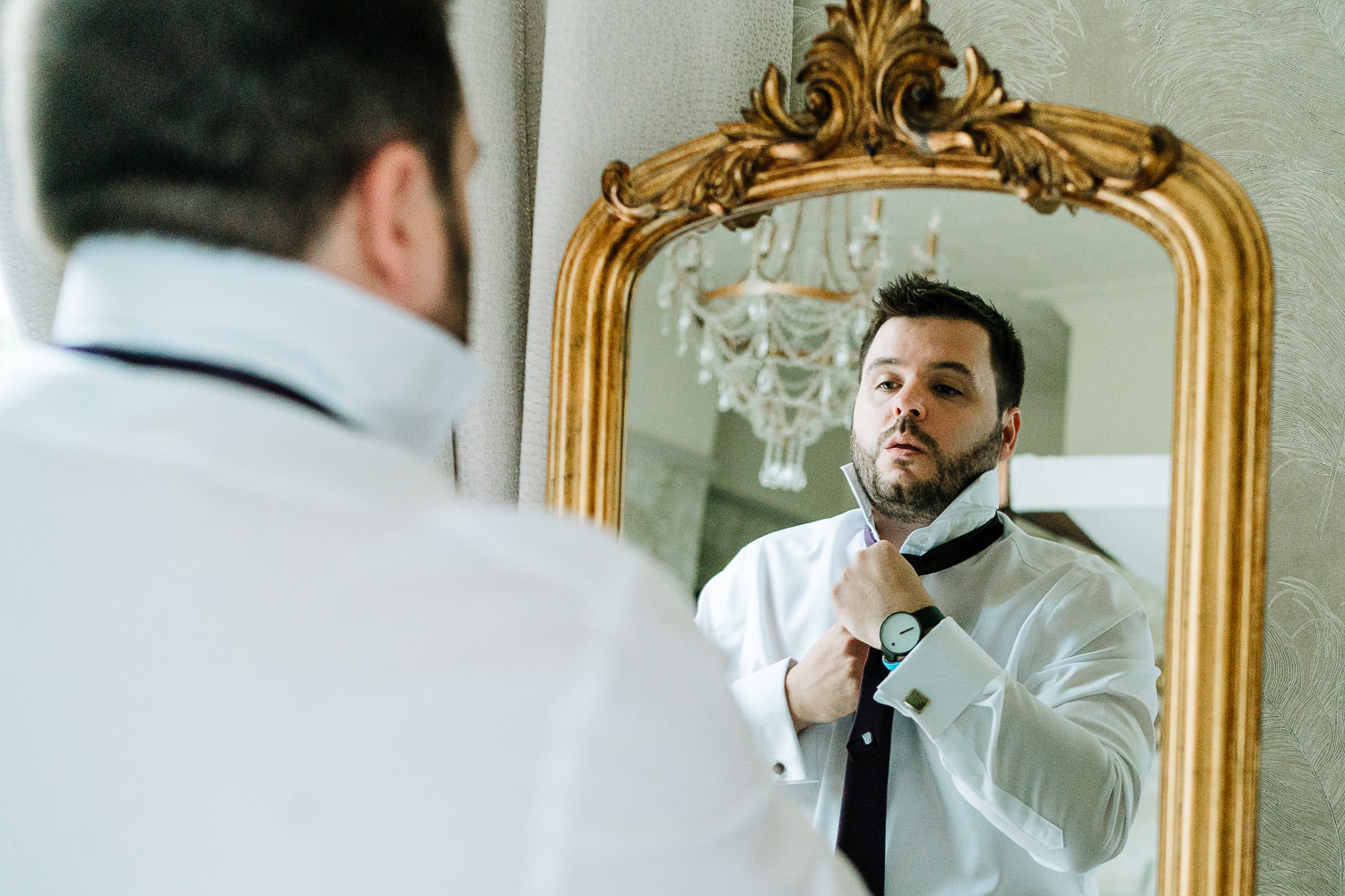 Groom getting ready at Ashfield house