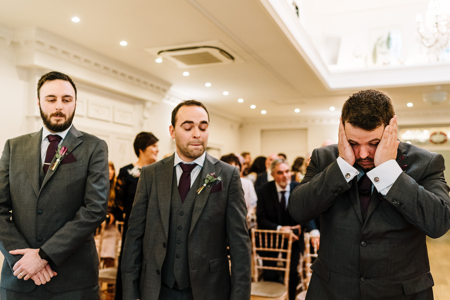 Groom waiting in Ashfield House and holding his face