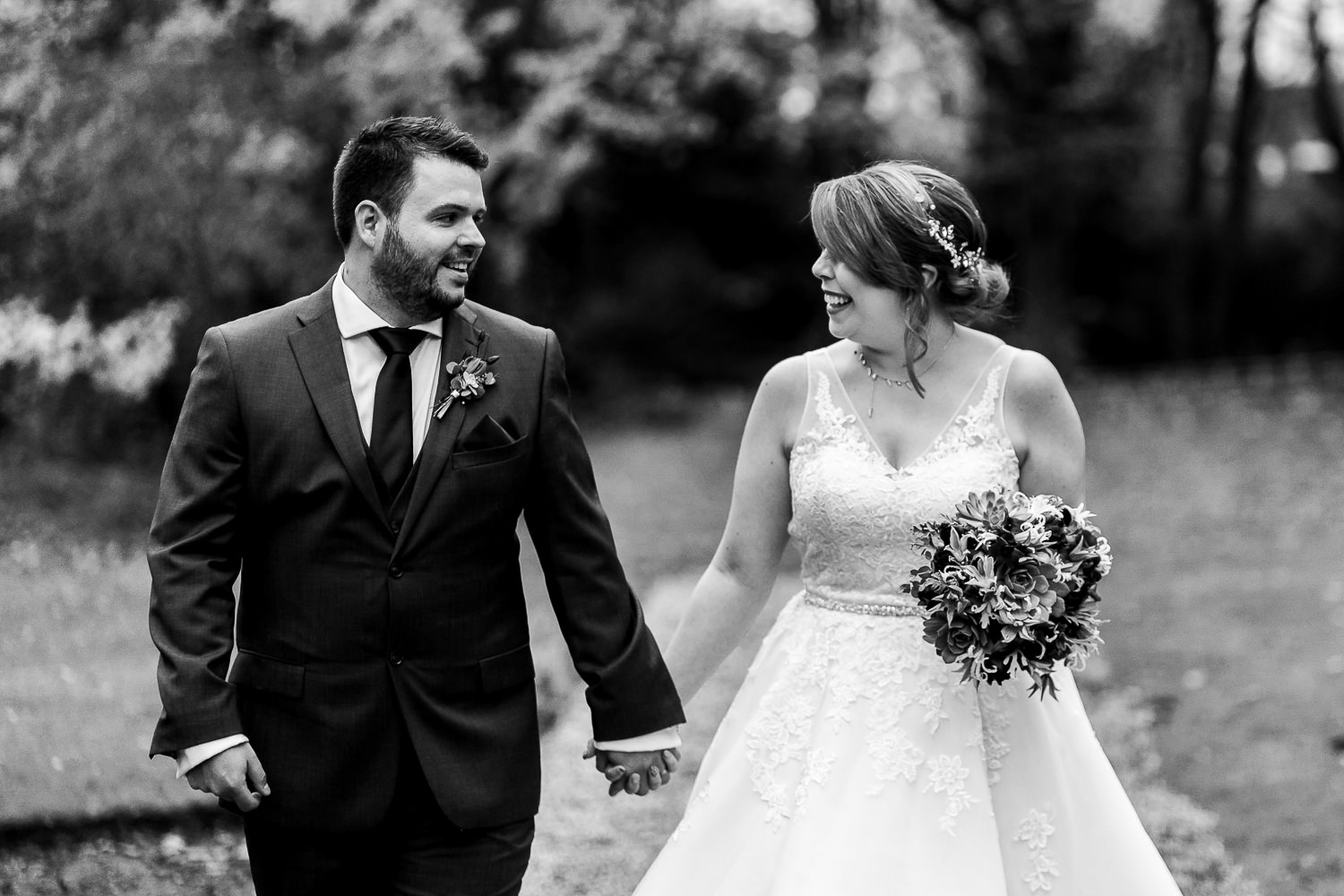 Bride and groom walking together at Ashfield House
