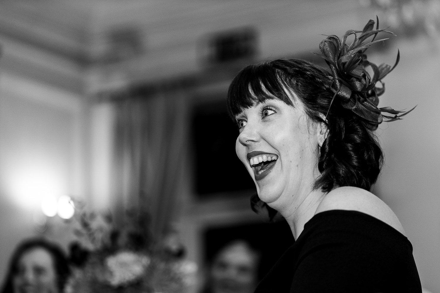 Guest laughing during speeches at Ashfield House