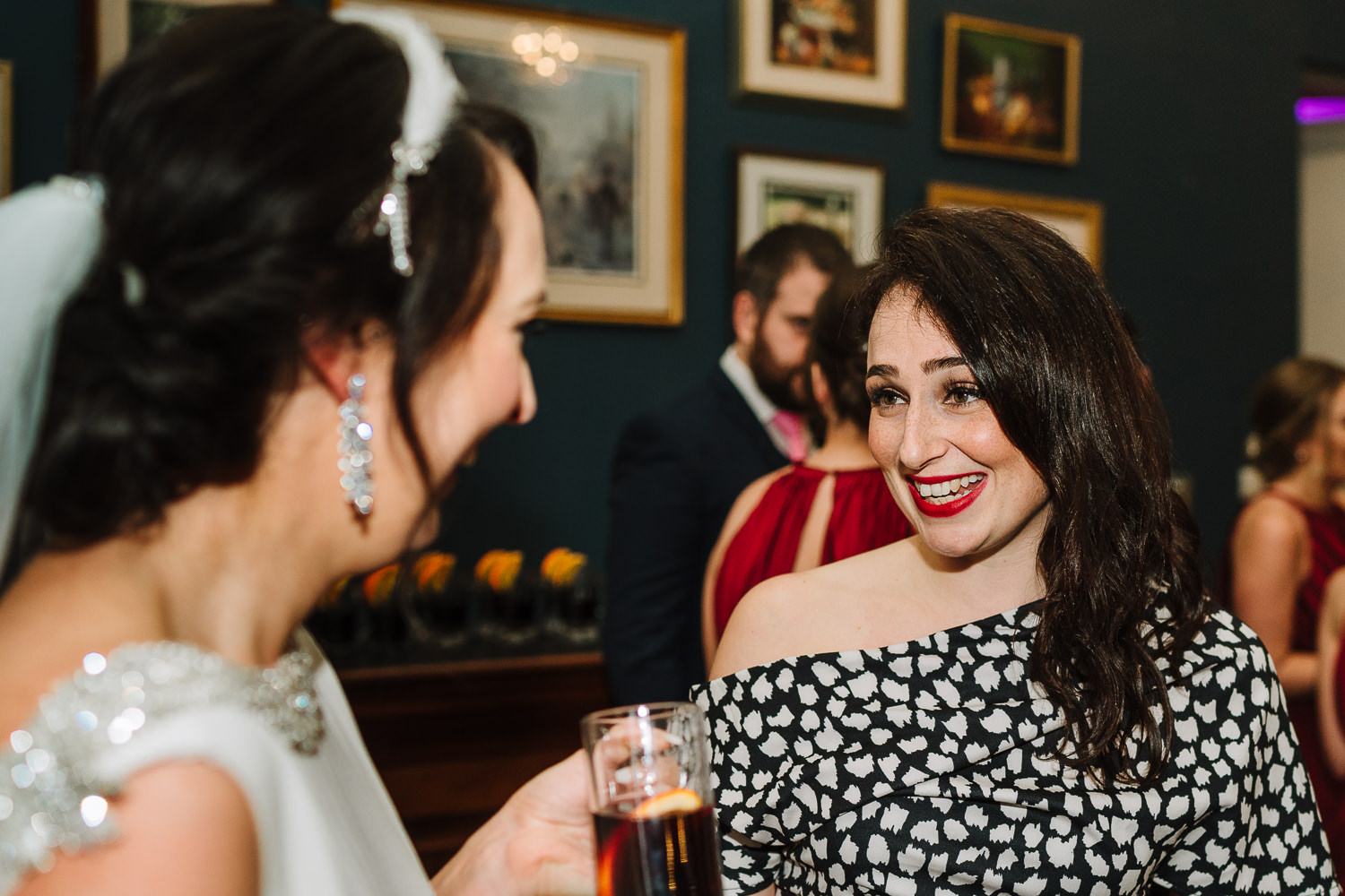 Bride smiling with a guest