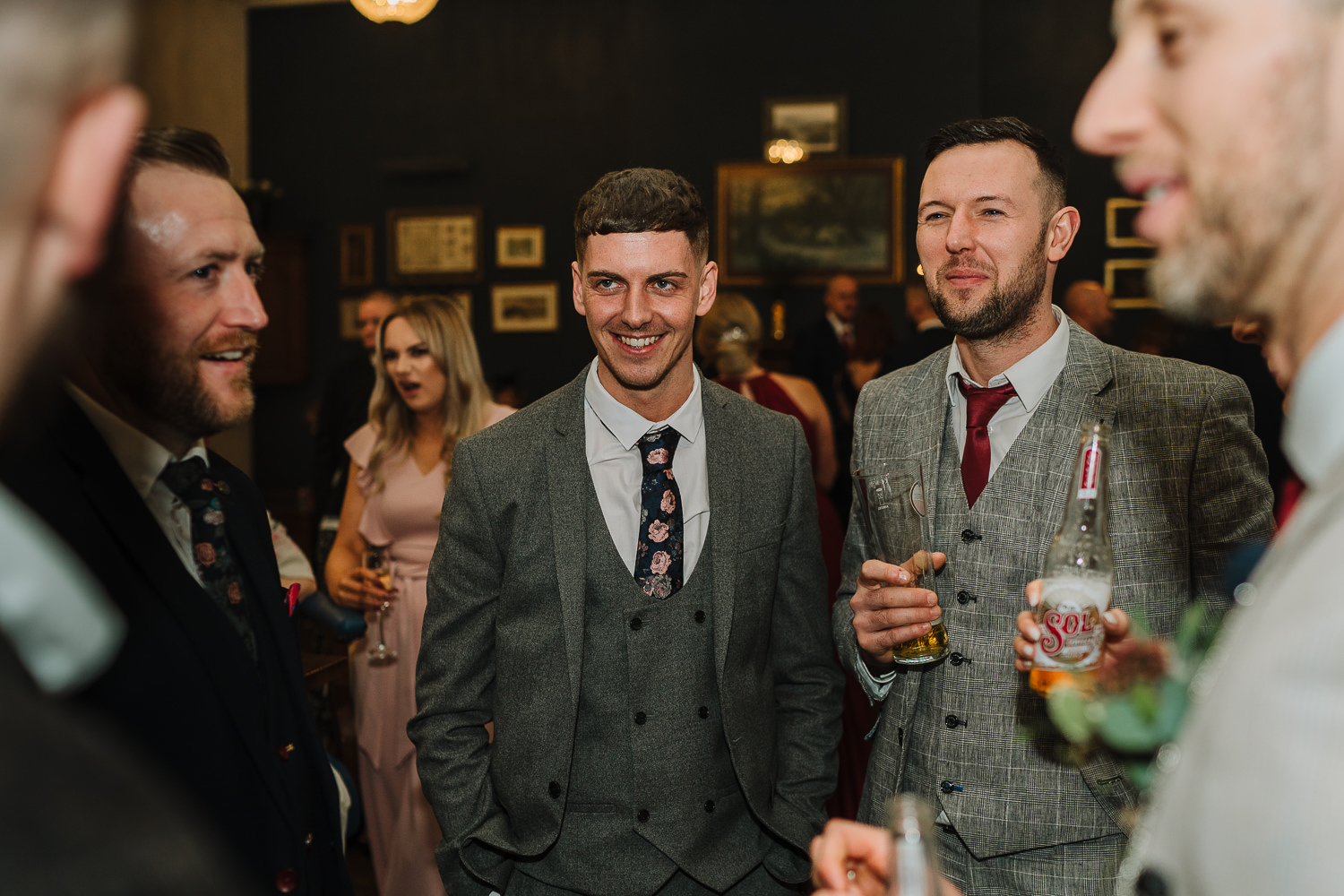 male guests laughing with the groom