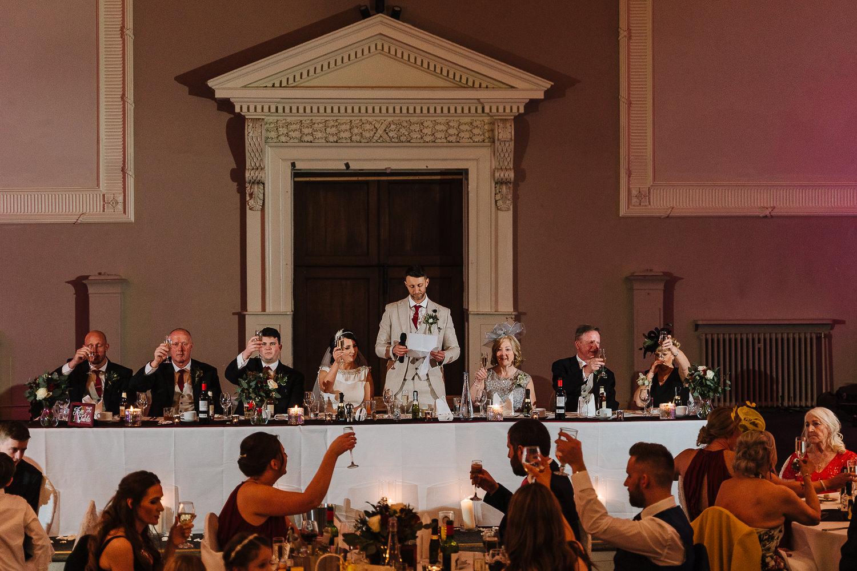 whole room shot for groom speech