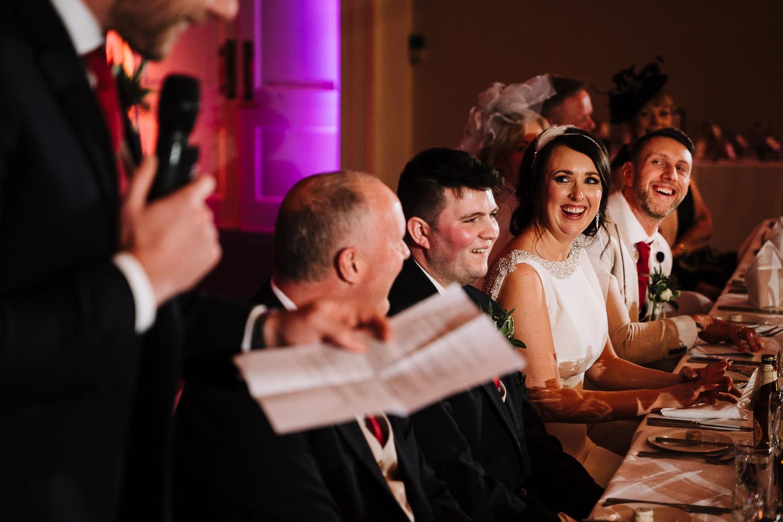 Best man speech looking on to bride