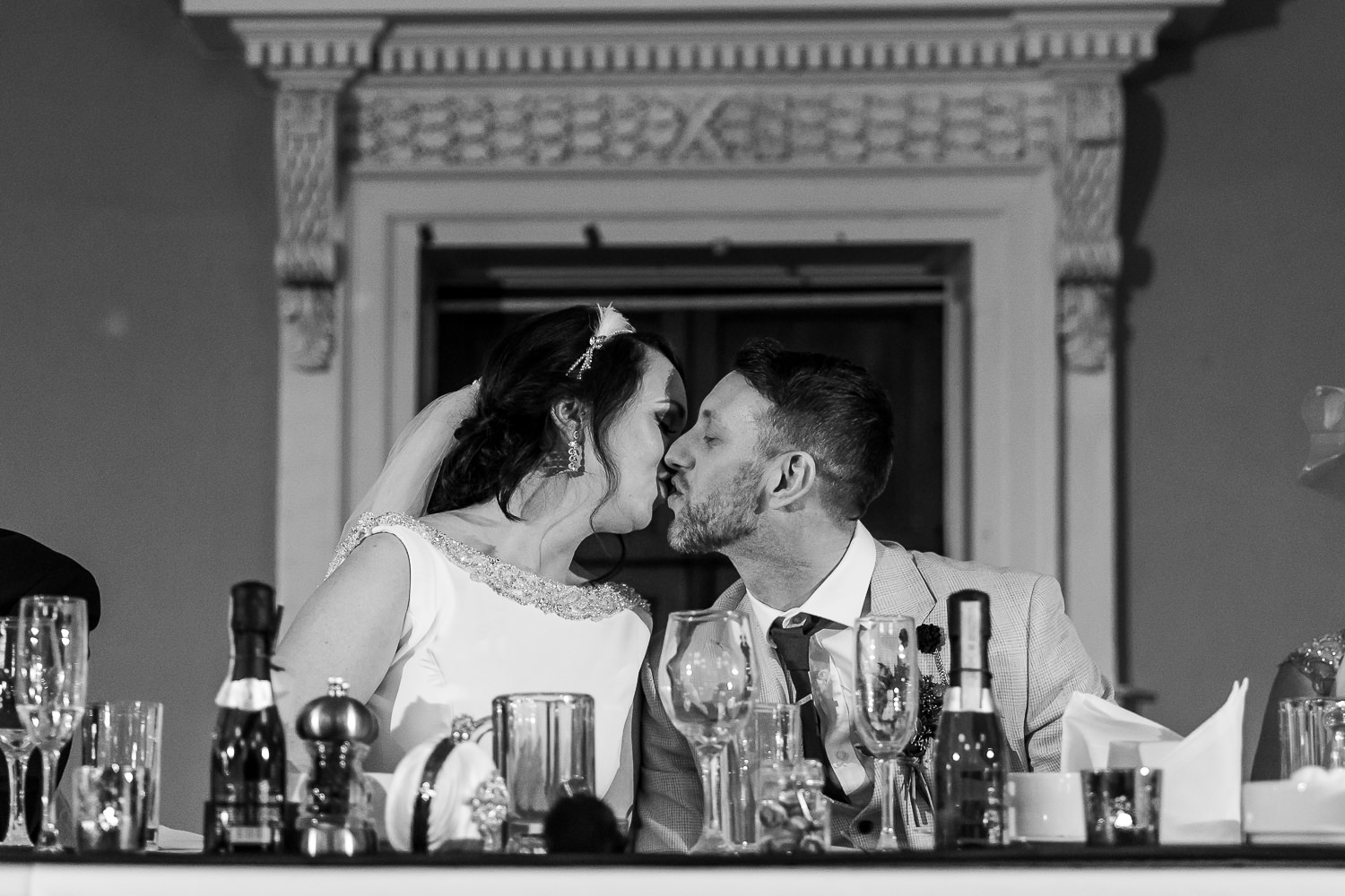 bride and groom kissing after speeches