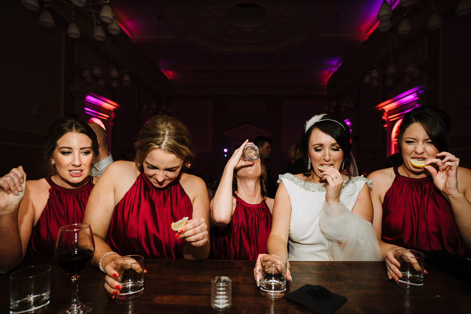bride and bridesmaids doing tequila at the Courthouse