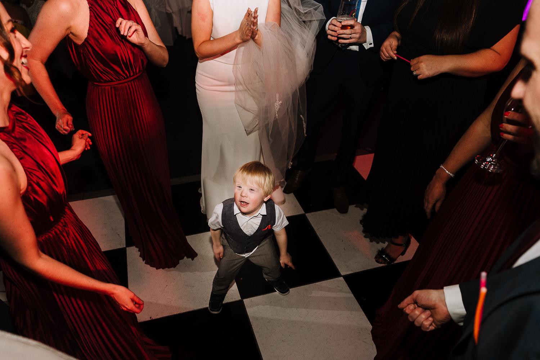 Little boy dancing on dance floor