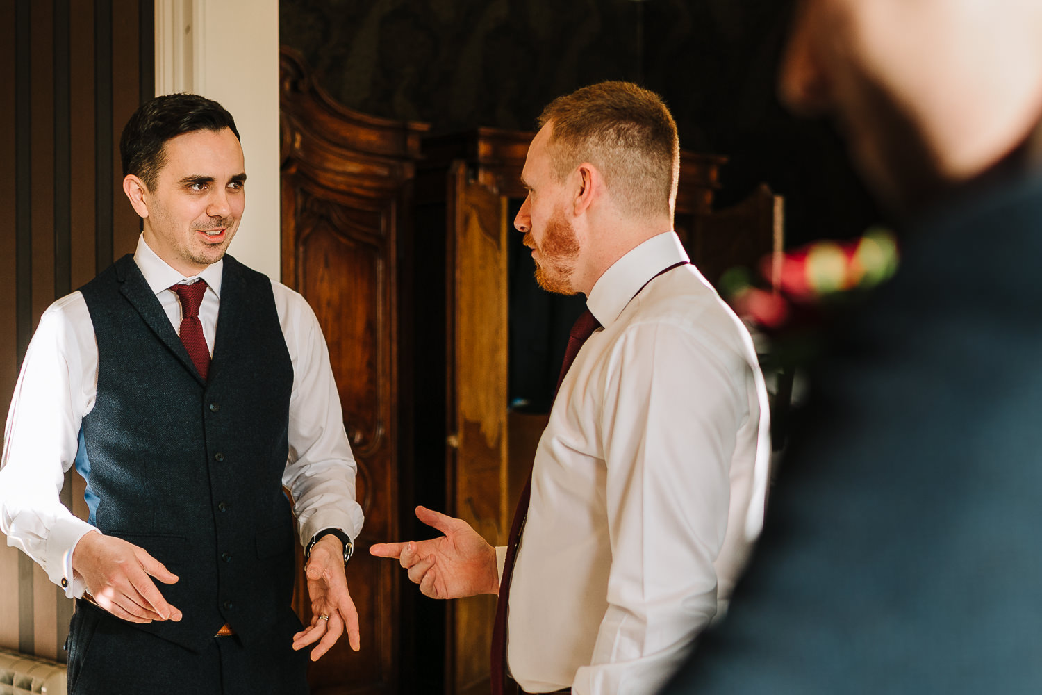 Groomsmen chatting in the bridal suite of Eaves Hall