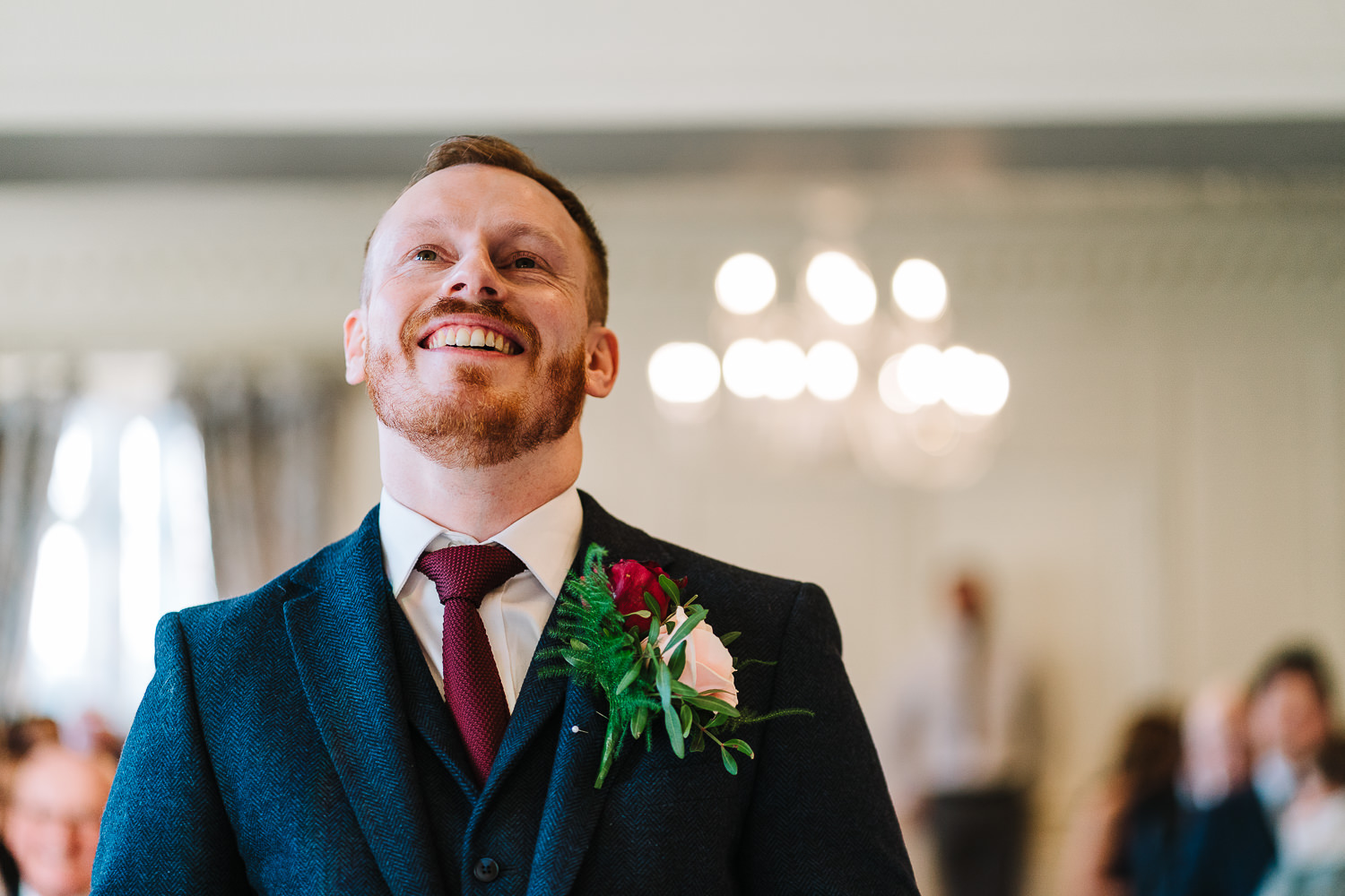 Groom smiling before the bride walks down the aisle at Eaves Hall