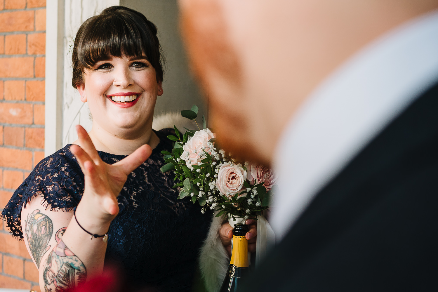 Bridesmaid laughing with groom