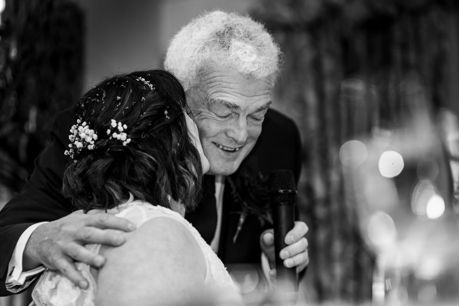 Bride hugging her dad at Eaves hall after the speech