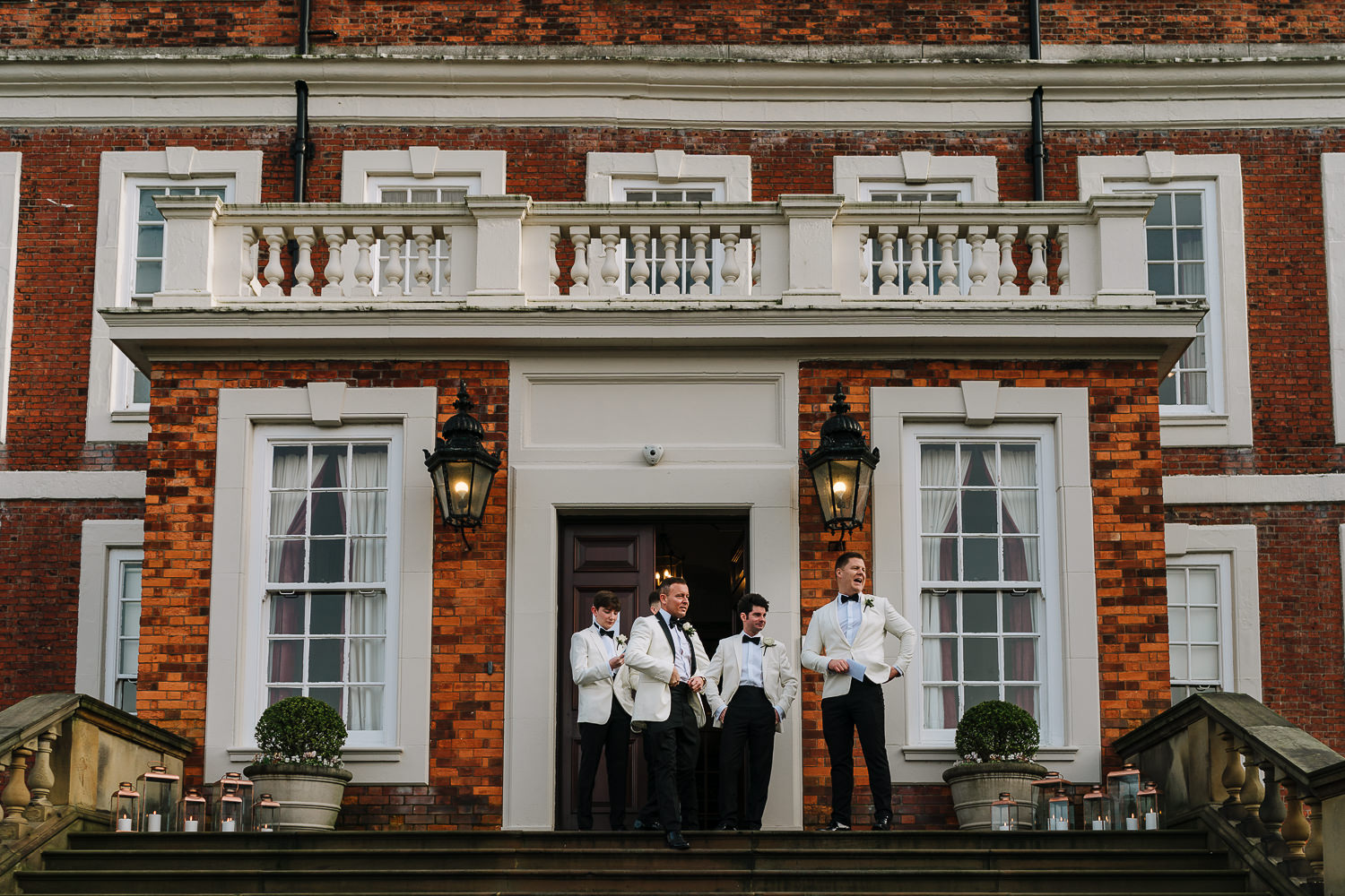 Groomsmen outside the door of Knowsley Hall