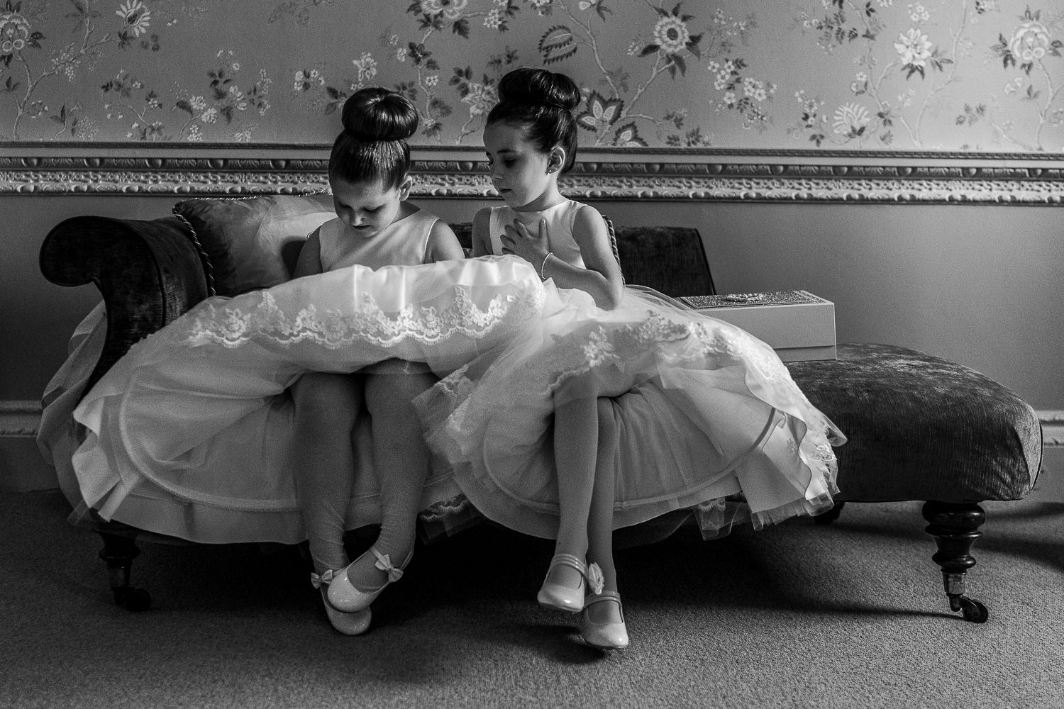 Two flower girls sitting