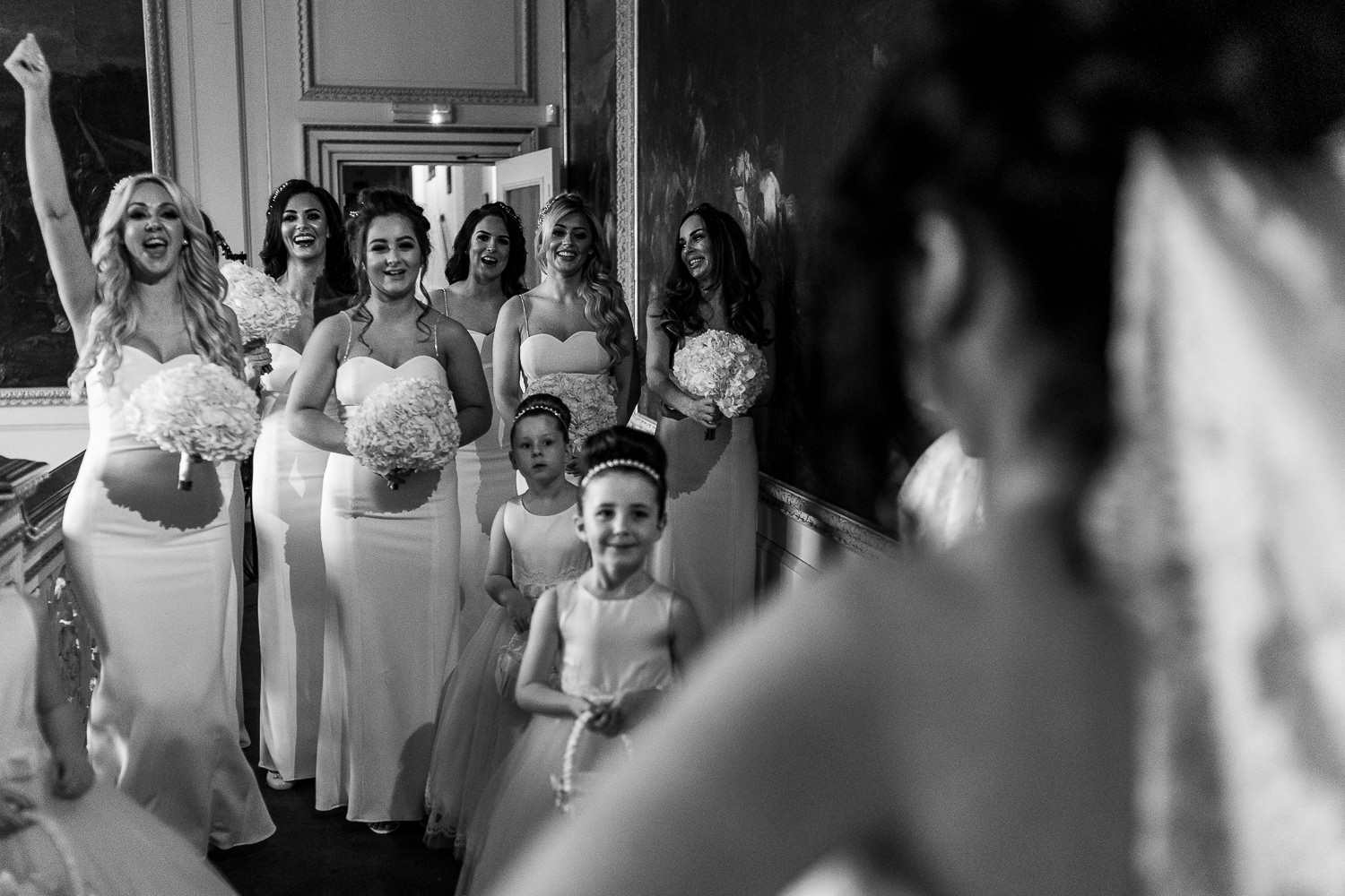 Bride seeing her bridesmaids for the first time