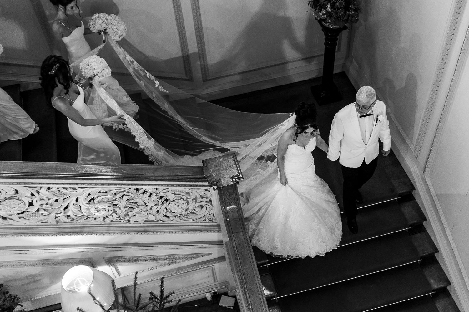 bride walking down the stairs at Knowsley Hall