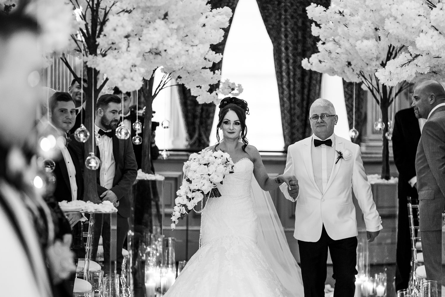 Bride and her dad walking down the aisle at Knowsley Hall