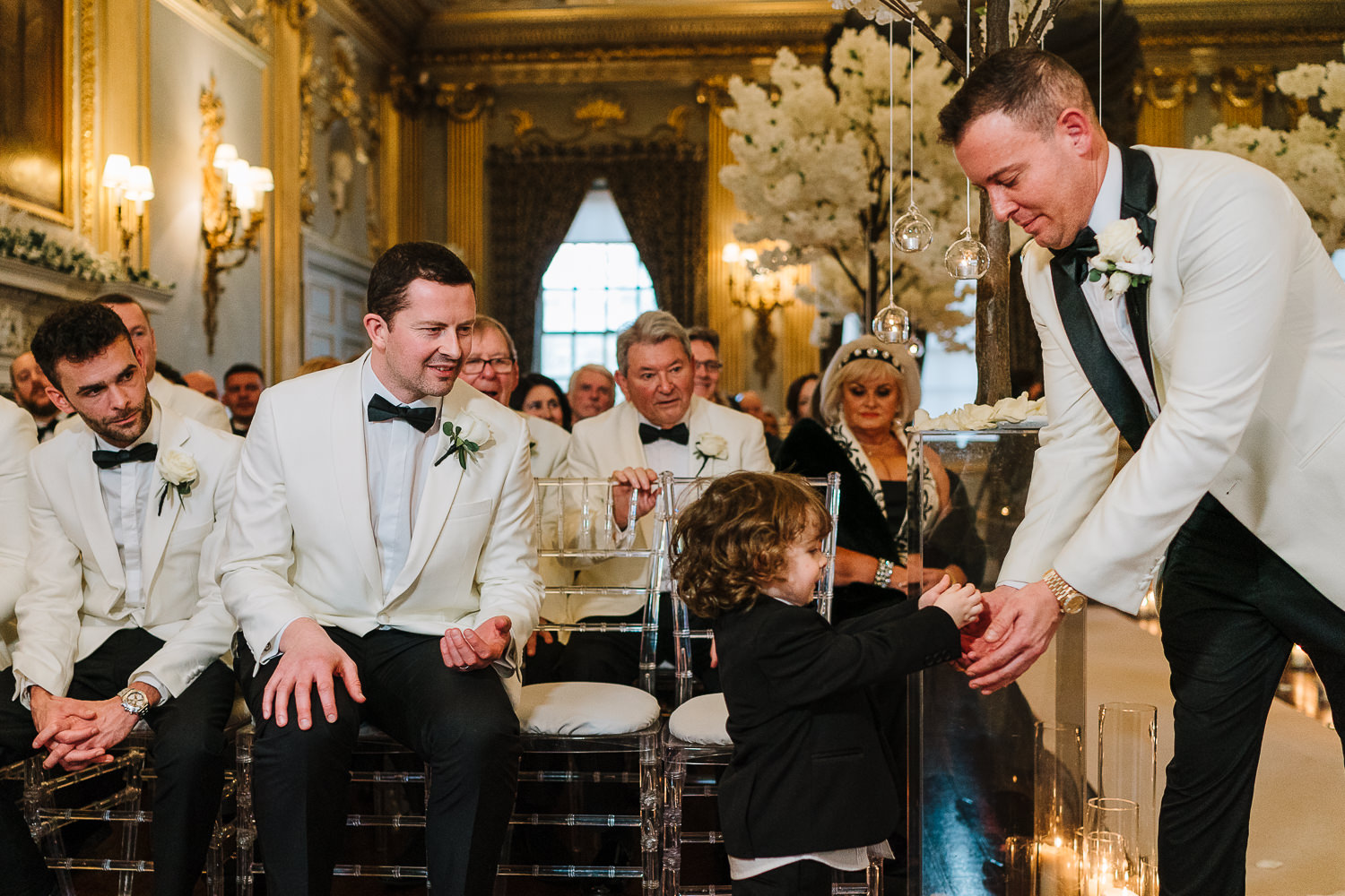 Groom getting the rings from page boy