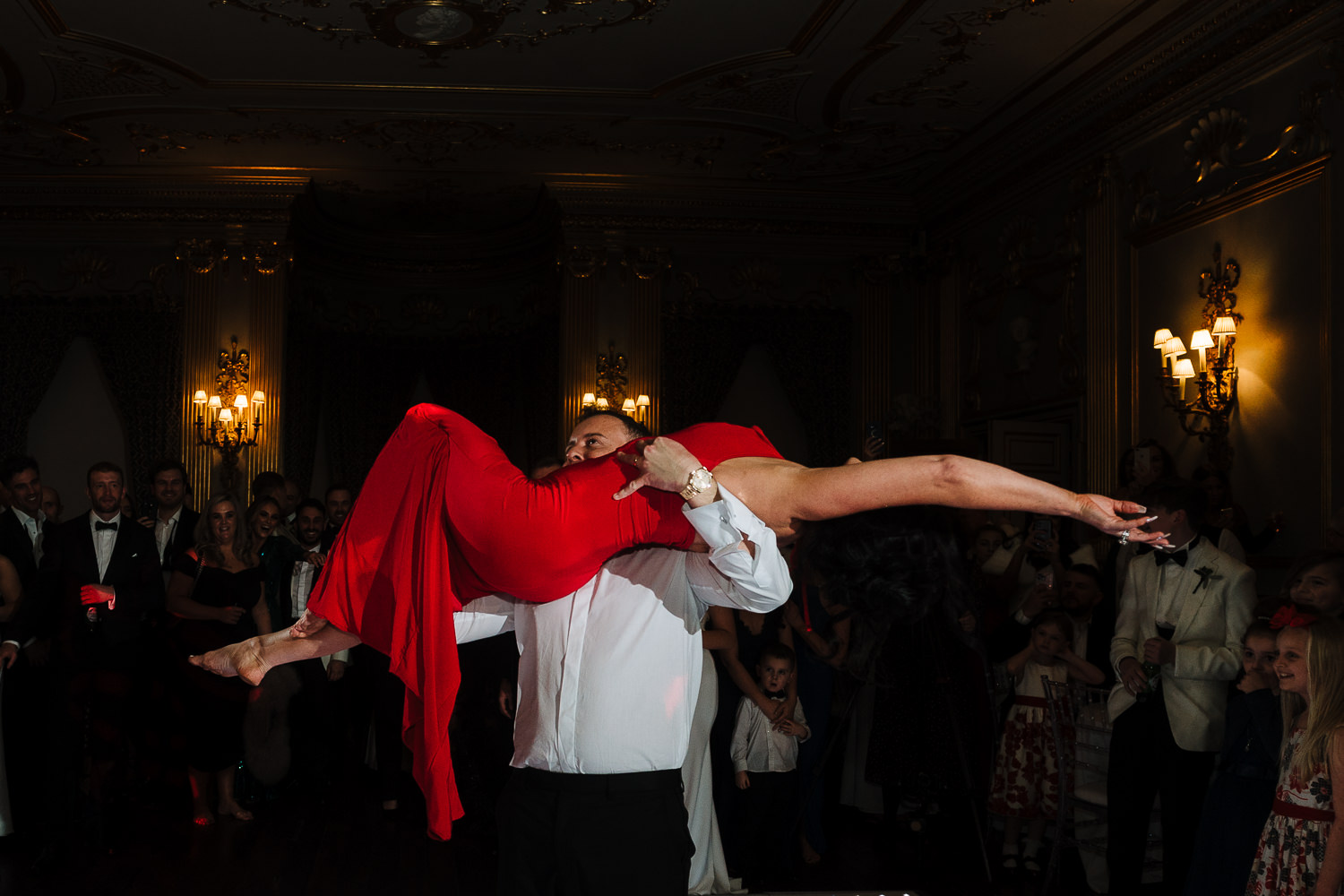 first dance at Knowsley Hall - groom carrying bride