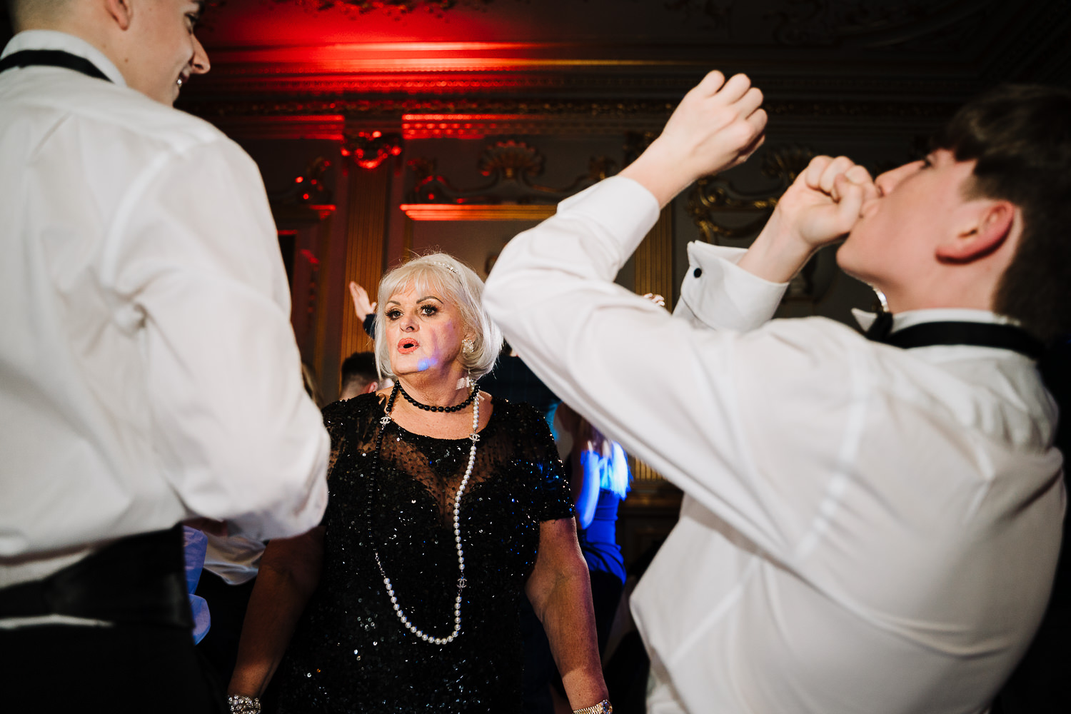 Mother of groom dancing with grandson