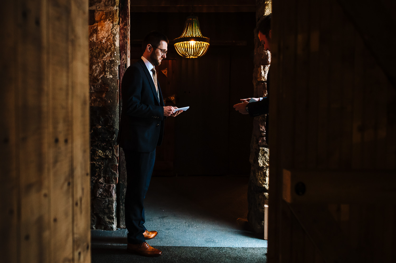 Groom reading his speech at the normans wedding venue