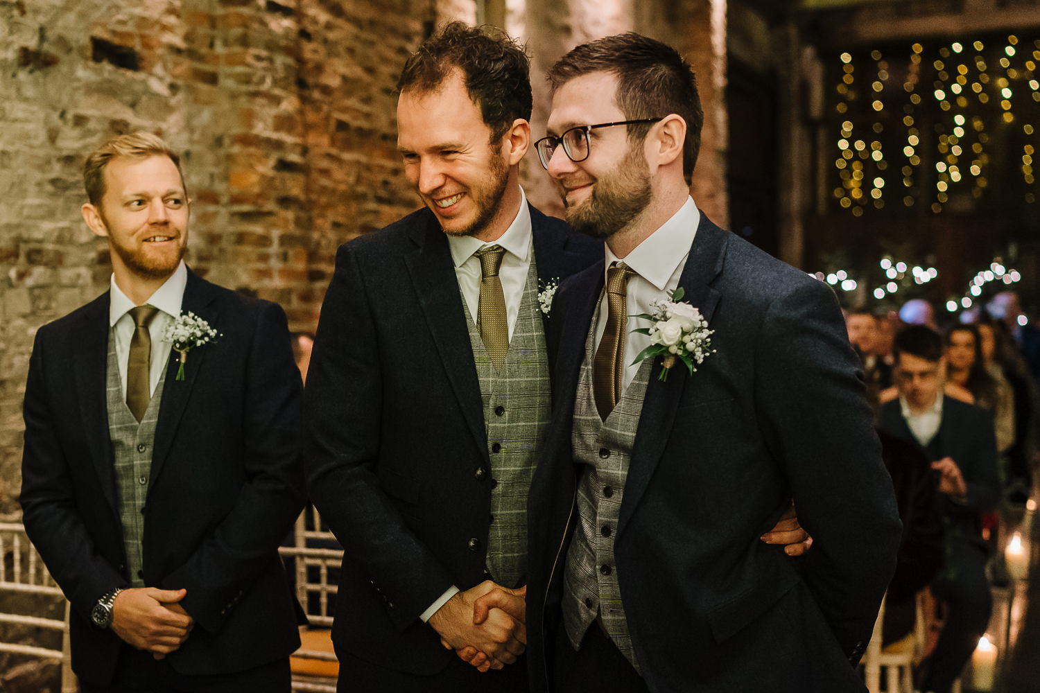 Groom shaking hands with best man