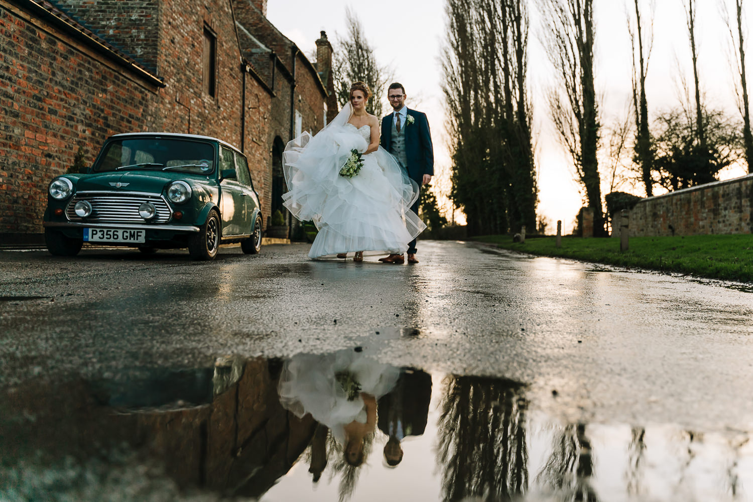 bride and groom walking back to the venue