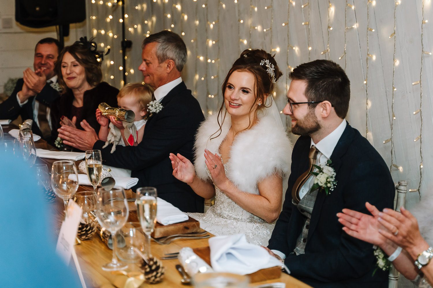 bride clapping the best man
