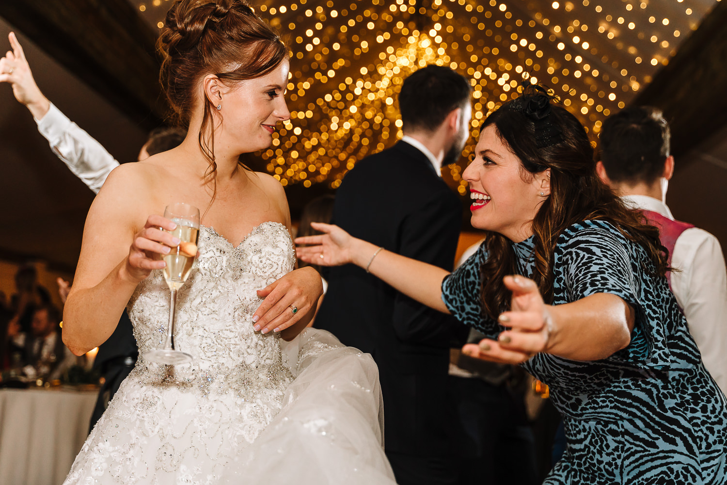 Female guest and the bride dancing