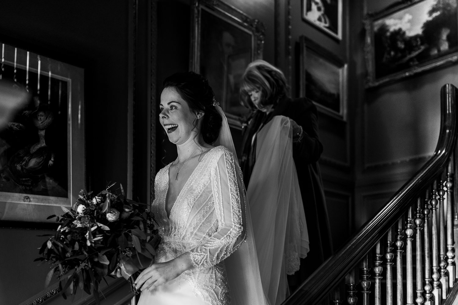 Bride walking down the stairs with her mum