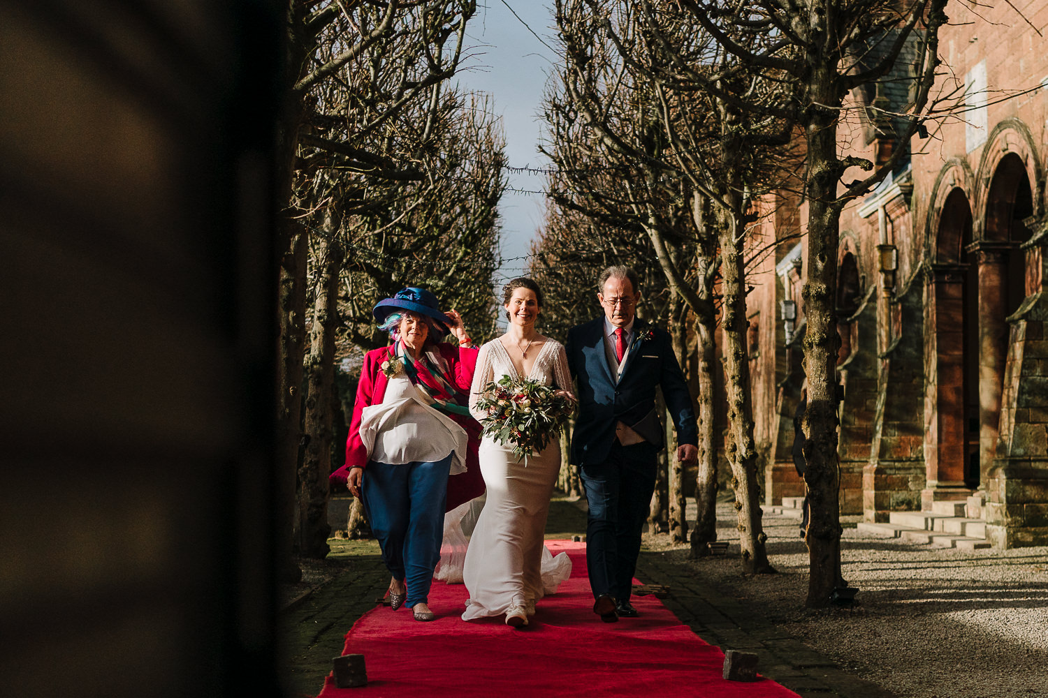 Bride and her parents walking into the ceremony at Thornton Manor
