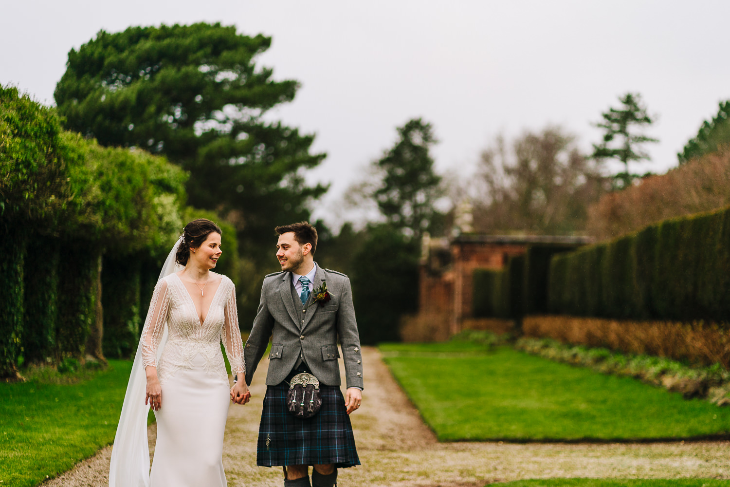 Bride and groom walking outside Thornton Manor