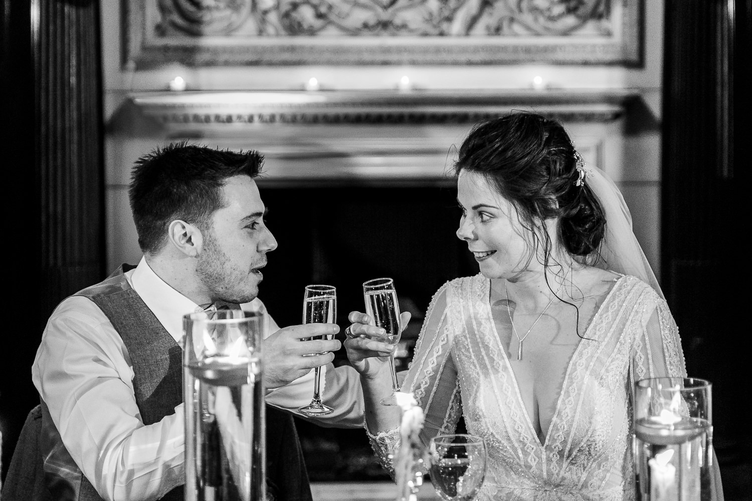 Bride and groom toasting together