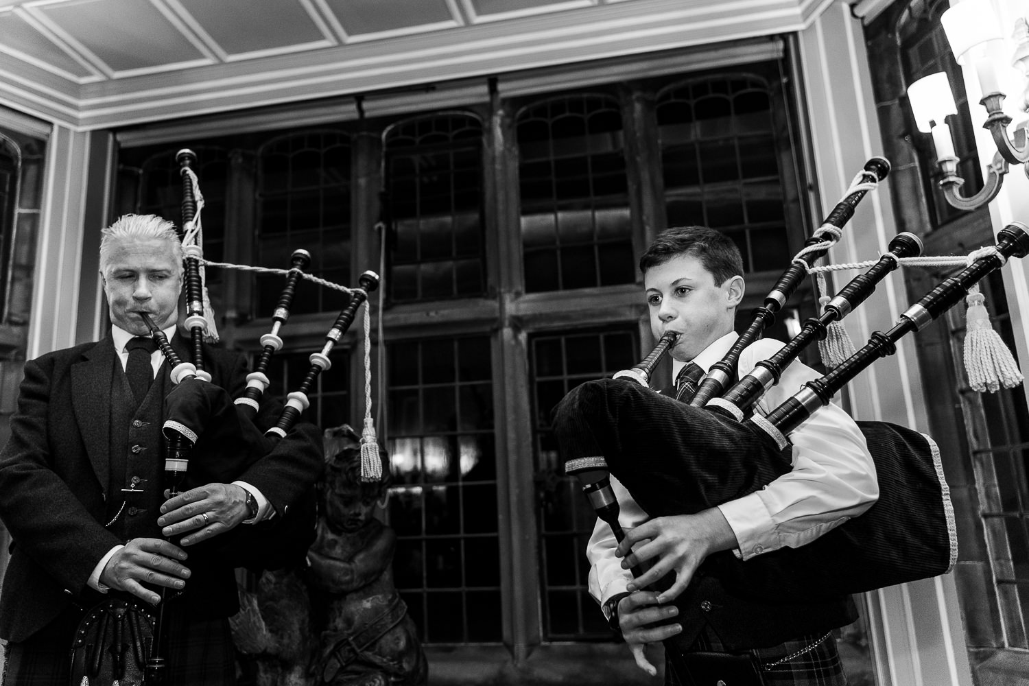 Son and dad playing the bag pipes