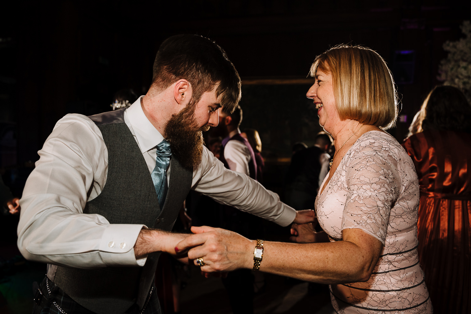 best man dancing with the mother of groom