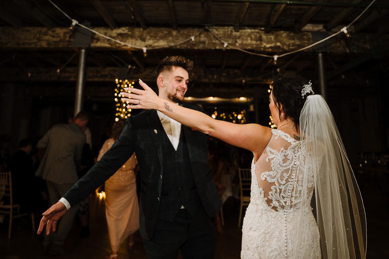 Bride and best man dancing