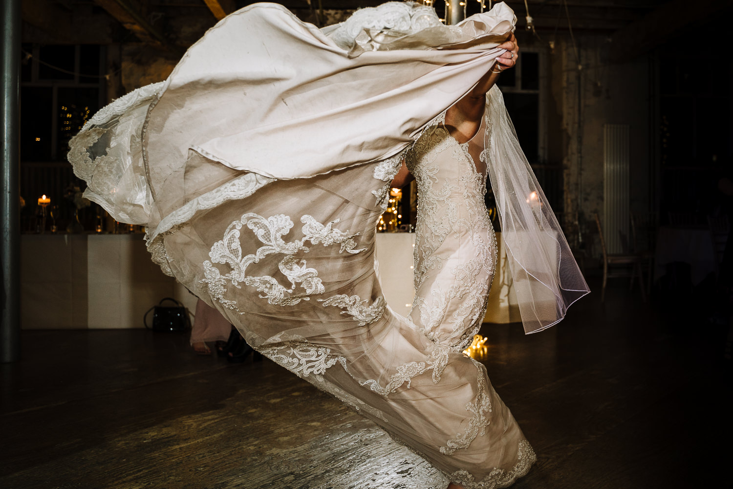 Bride dancing with her dress