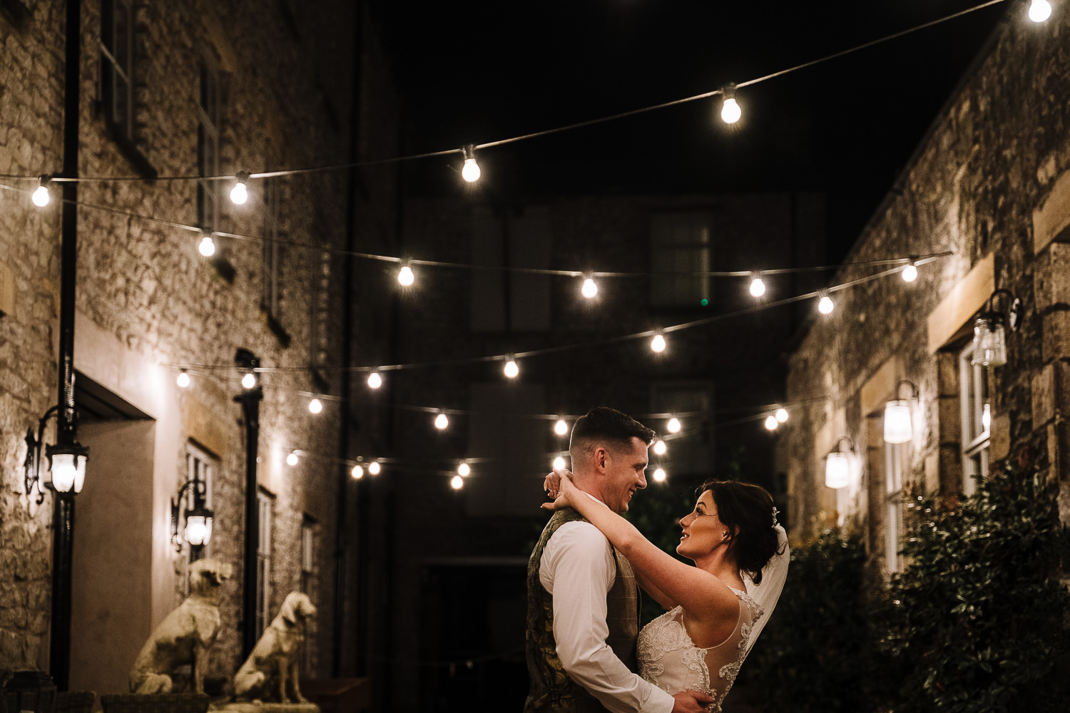 bride and groom outside Holmes Mill at night