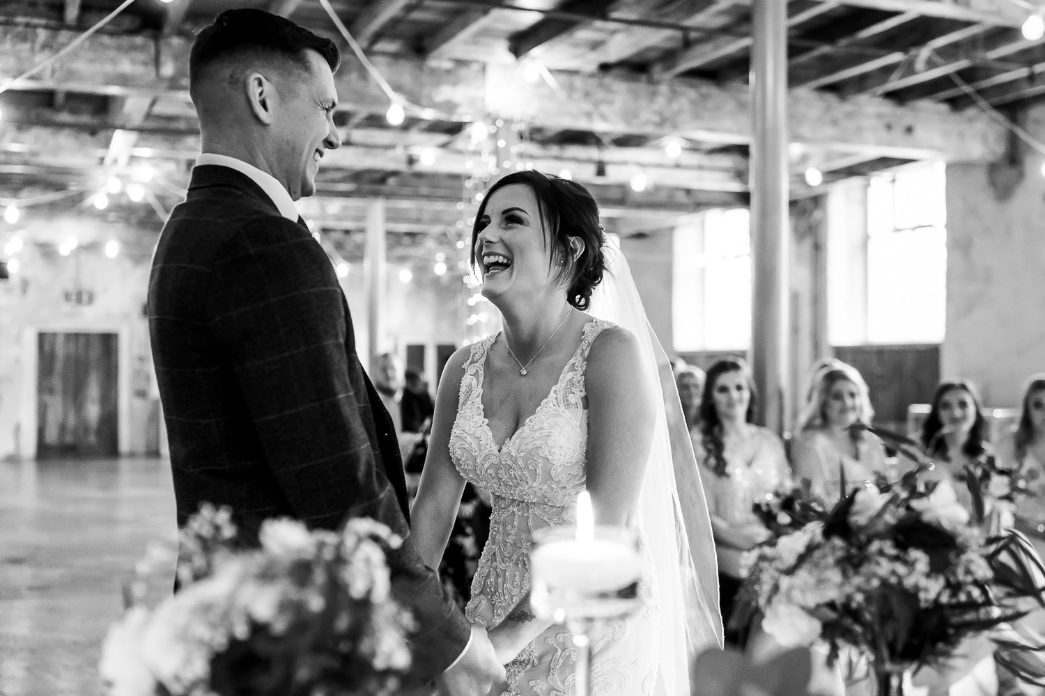 Bride and groom laughing at Holmes Mill